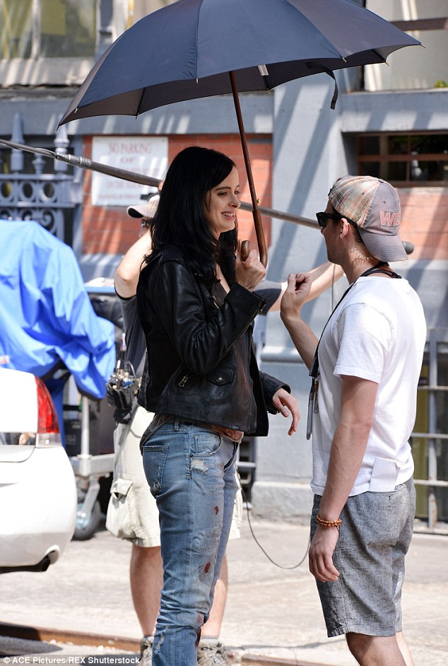 Enjoying her break: The TV star was all smiles as she chatted with a crew member on a break from filming