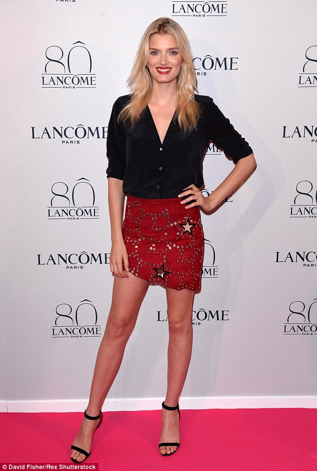Leggy as ever: Blonde beauty Lily Donaldson flashed her supermodel pins in a tiny red skirt with holes, and a simple black shirt