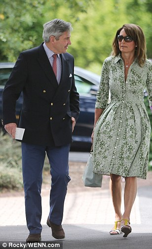 Making an entrance: Carole and Michael Middleton arrive to see the action at Wimbledon this afternoon