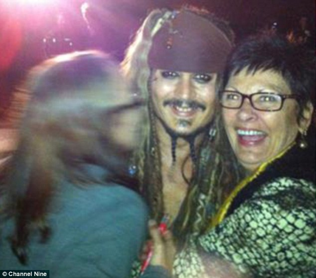 Vicky gratefully declined Mr Depp's kind offer, having already paid the power bill, and settled with taking photos with him instead