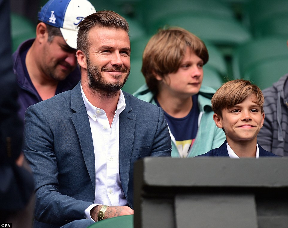 Father and son: David Beckham was joined on court by his 12-year-old Burberry model son Romeo