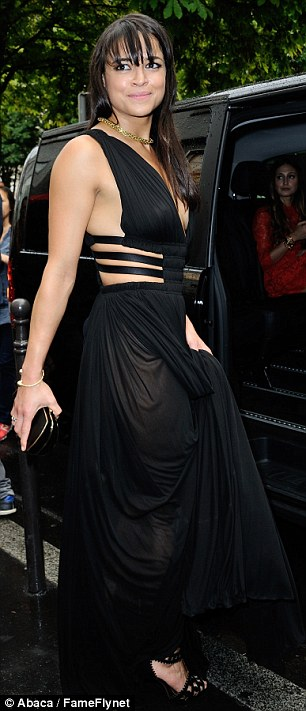 Stunning!Rodriguez looked amazing in a flowing black plunging cut-out floor length gown
