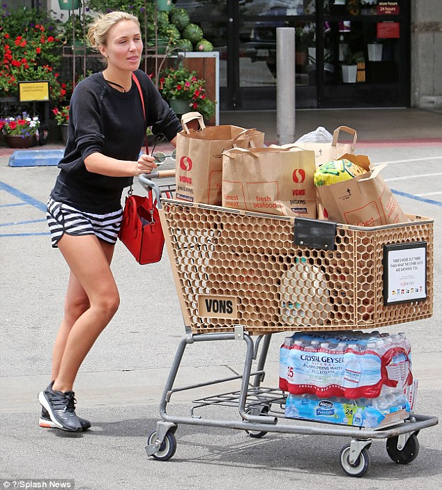 Don't forget to drink! The model is keeping her family hydrated in their new hot climate as she exited the food store with 59 bottles of water and 12 cans of Diet Coke