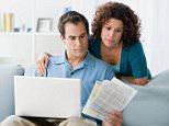 Couple looking at home finances on computer. A3JBHT  debt, internet, sofa, technology, debt, internet, sofa, technology