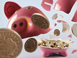 broken piggy bank showing coins coming out of he  piggy bank