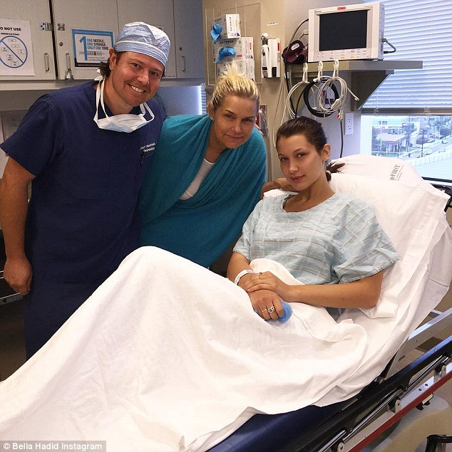 'Why are we all smiling?': The 18-year-old also shared a snapshot to Instagram which showed her posing in a hospital bed with her mother and doctor