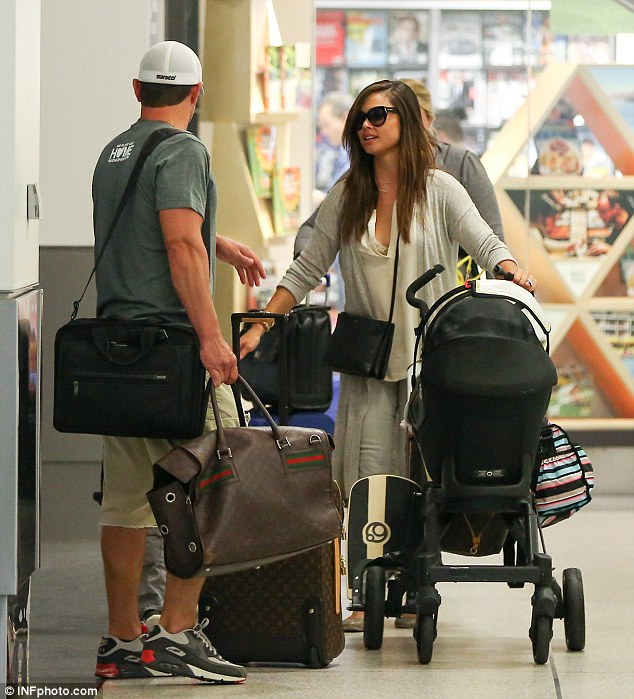 Taking a breather:Laden with luggage, Nick appeared to take a brief break inside the transport hub