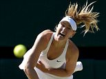 Maria Sharapova of Russia serves during her match against Serena Williams of the U.S.A. at the Wimbledon Tennis Championships in London, July 9, 2015.                                    REUTERS/Toby Melville       TPX IMAGES OF THE DAY