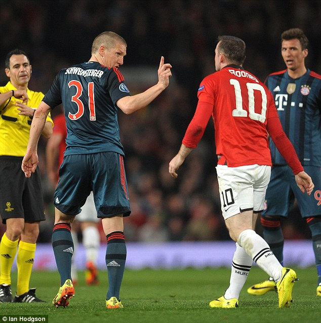 Schweinsteiger wags his finger at Wayne Rooney after an incident in the tie. The German was later sent off