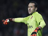 """Arsenal's Colombian goalkeeper David Ospina gestures during the English League Cup third round football match between Arsenal and Southampton at The Emirates Stadium in London on September 23, 2014. AFP PHOTO / IAN KINGTON  RESTRICTED TO EDITORIAL USE. No use with unauthorized audio, video, data, fixture lists, club/league logos or """"live"""" services. Online in-match use limited to 45 images, no video emulation. No use in betting, games or single club/league/player publications.        (Photo credit should read IAN KINGTON/AFP/Getty Images)"""