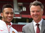 MANCHESTER, ENGLAND - JULY 10:  Memphis Depay (L) of Manchester United poses with manager Louis van Gaal ahead of a press conference to announce his signing at Old Trafford on July 10, 2015 in Manchester, England.  (Photo by Matthew Peters/Man Utd via Getty Images)