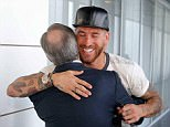 Ramos, the subject of a failed bid by Manchester United, hugs president Florentino Perez earlier in the week