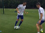 Terry prepares to take on Cahill in a training dribbling drill