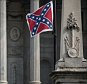 COLUMBIA, SC - JULY 8:  The Confederate battle flag flies at the South Carolina state house on July 8, 2015 in Columbia, South Carolina. State lawmakers debated in the House for over thirteen hours and eventually approved a senate bill to remove the flag early Thursday morning. (Photo by Sean Rayford/Getty Images)