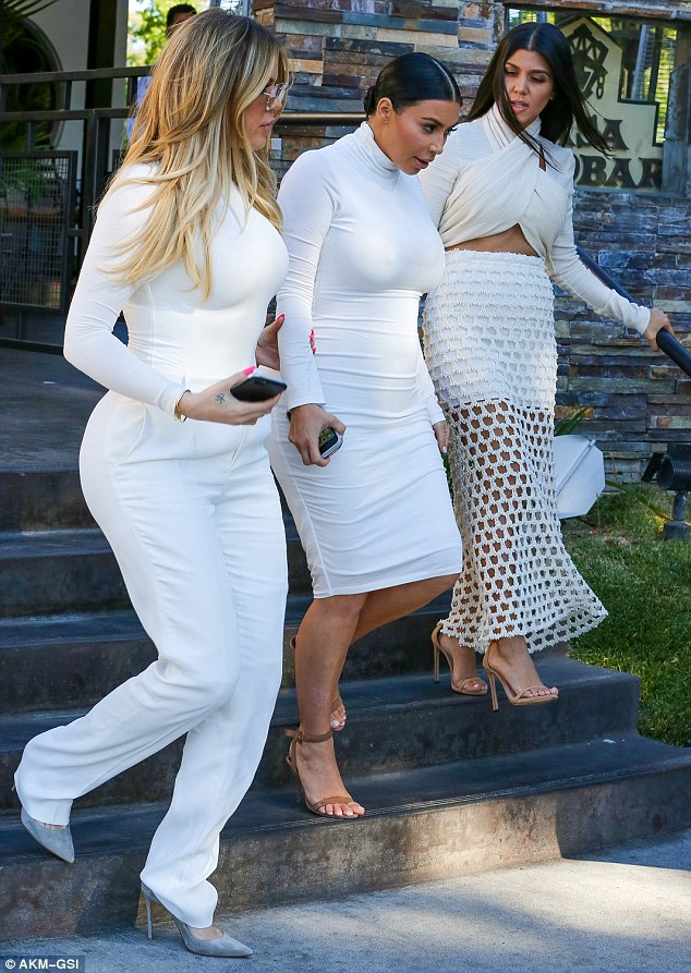 Business as usual: The 36-year-old had to film Keeping Up With The Kardashians alongside her siblings