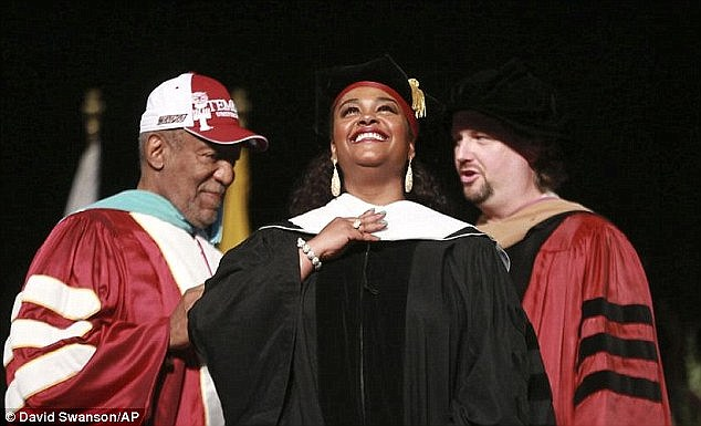 The Philadelphia-born singer received an honorary doctorate from Temple University in May 2014 and was photographed receiving it from Cosby