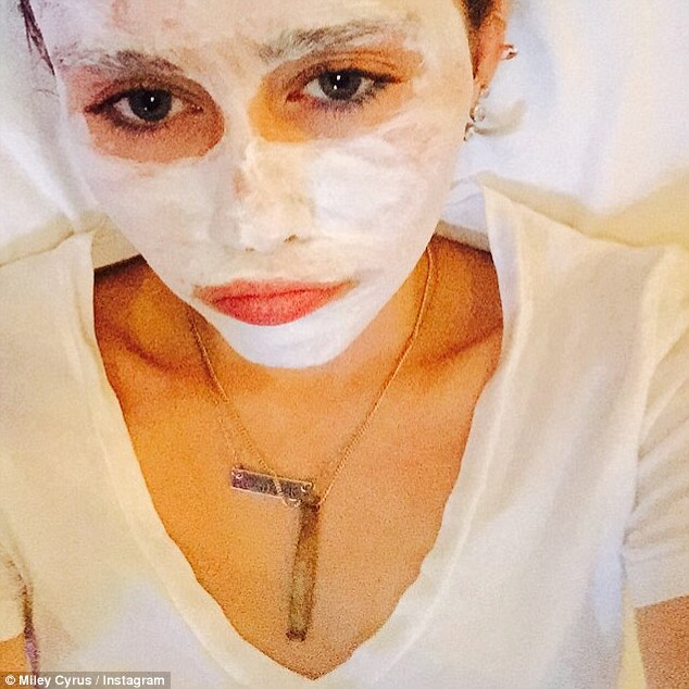 '2 daze been ruff': Miley resorted to a quiet night in on Wednesday and found herself in a face mask