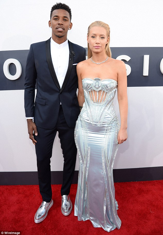 Moving on: It's no wonder the rapper is willing to endure the pain of getting her tattoo lasered off as things are getting very serious between Iggy and her Lakers boyfriend Nick Young of late
