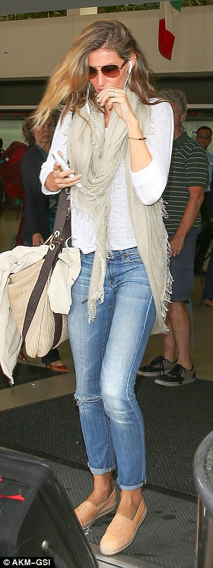Chic touch: While embracing a predominately casual look that day, Gisele added an elegant aspect with her Chanel footwear