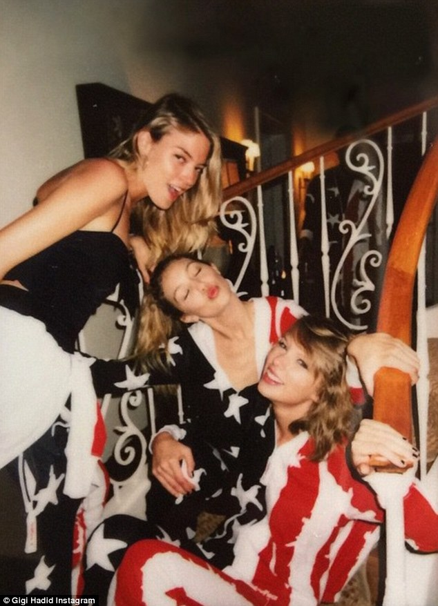 Patriotic pajamas: Thanks to a gift from Gigi Hadid (centre) and Joe Jonas, the party-goers were clad in flag-designed onesies