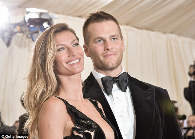 That's more like it! The Vogue doll with blonder hair as she posed with husband Tom Brady in May 2014