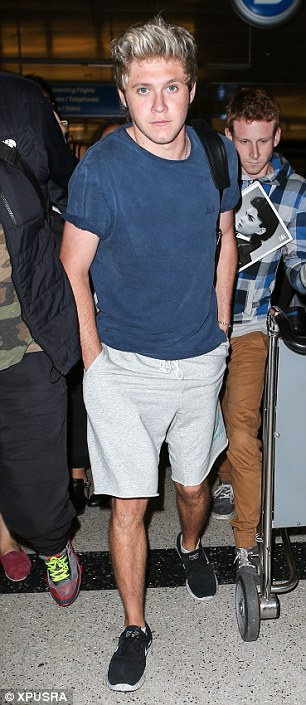 Ready for more: Niall dressed down in Nike shorts and a blue t-shirt as he flew in ahead of One Direction's tour dates in California this week