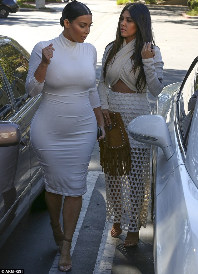 Supportive: Kim chatted away to Kourtney as they stepped out of the car