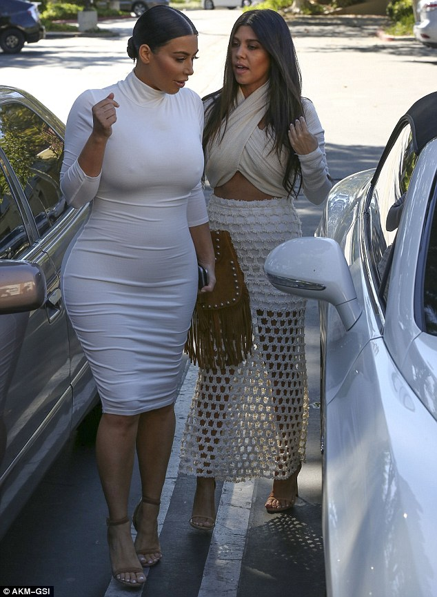 Sexy: Kourtney looked stunning in a midriff-baring halter-neck and mesh maxi skirt