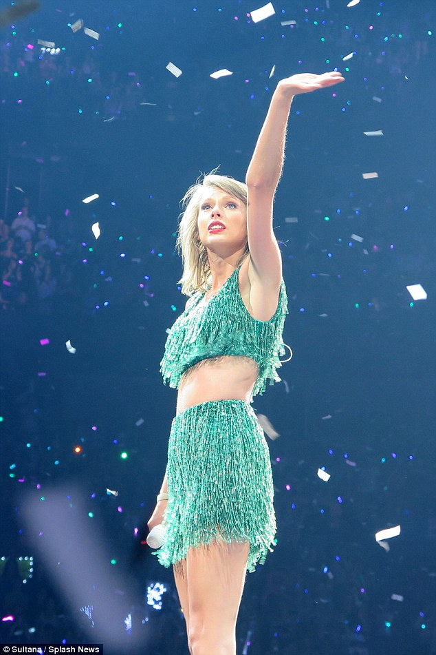Flirty: Taylor opted for a more girly look, with this fringed green crop top and skirt