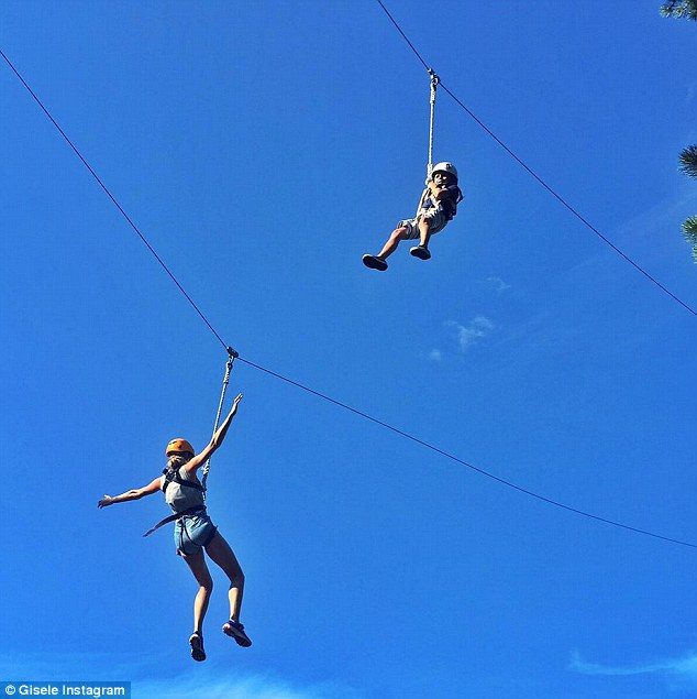 Soaring: On Monday, Gisele Instagrammed a photo of herself and her five-year-old son Benjamin spending some quality time together on a zip line