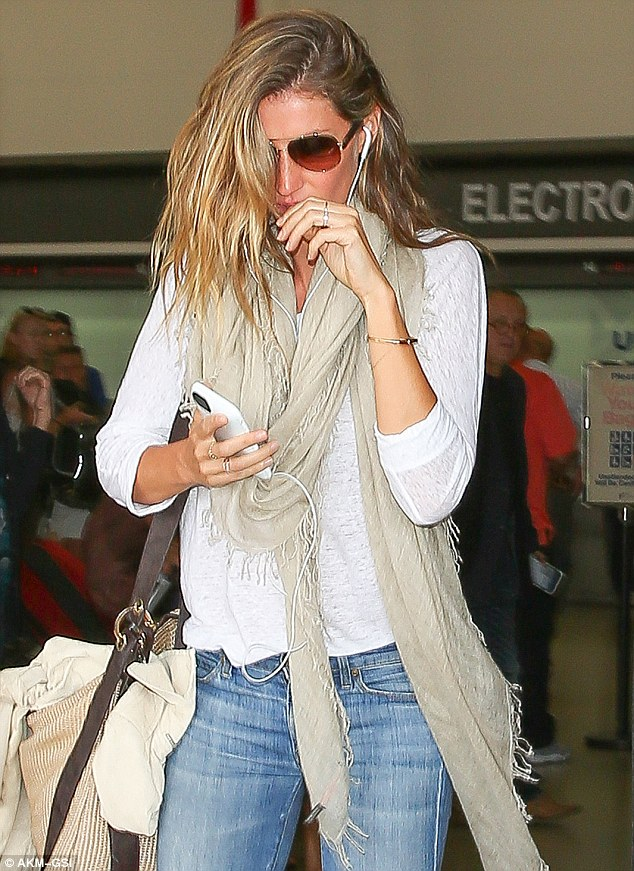 Roots already! Gisele Bundchen showed off her natural light brown roots when she ducked through arrivals at LAX on Tuesday