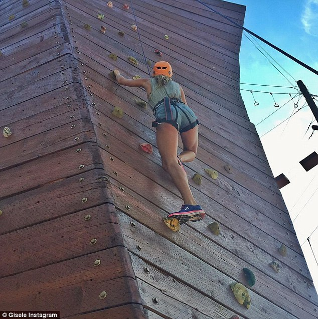 Sporty: The model shared a photo of herself climbing up a rock wall on Instagram on Monday