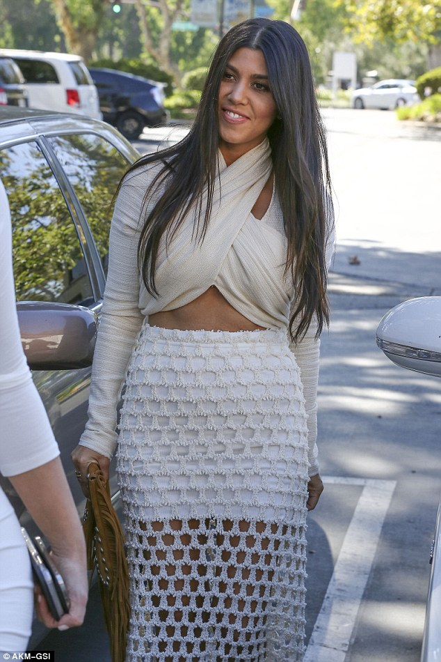Putting on a brave face: Kourtney managed a smile as she stepped out a day after splitting from Scott Disick