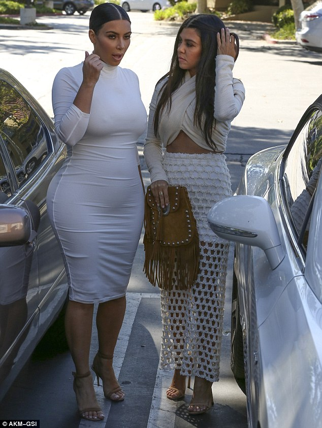 Baby on board: Pregnant Kim showcased her changing figure in a skintight dress