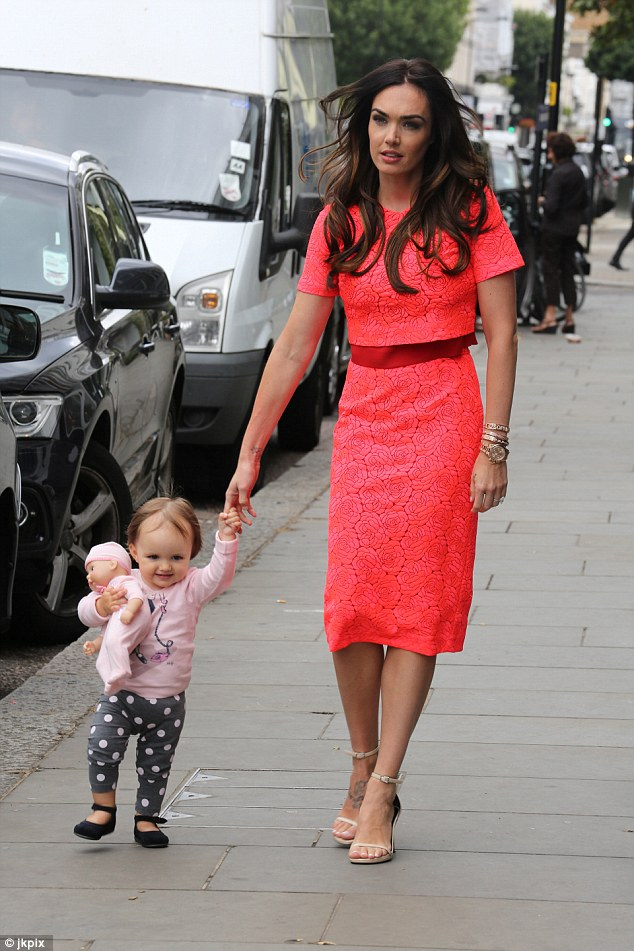Girls' day out: Tamara Ecclestone walked hand in hand with her daughter Sophia, one, to her London beauty salon for a day of pampering and filming on Tuesday