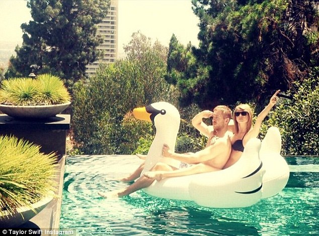 Affectionate: Taylor shared this photo of her and Calvin in the pool in June