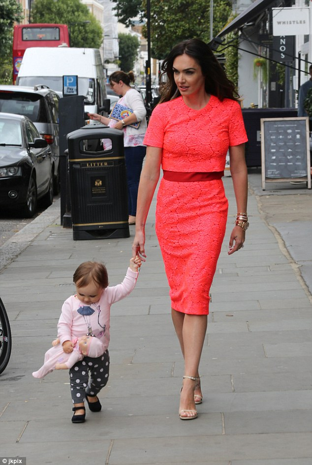 All dressed up: Tamara looked gorgeous in her summery coral dress with clinched in waist detail