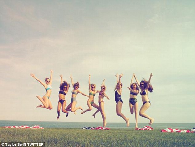 Jumping for joy! On the far left, Gigi shows off her model figure in a blue bikini, Empire star Serayah sports a black two-piece jumping next to Taylor, while Victoria's Secret beauty Martha keeps two feet on the ground