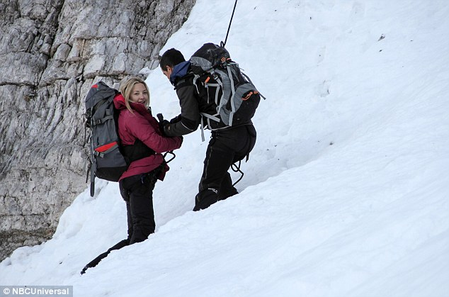 On the up: Hudson carried a large rucksack on her back as she trudged through snow at higher elevations