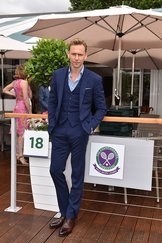 Dashing gentleman: Actor Tom Hiddleston looked dashin in a Ralph Lauren purple label suit, a striped cotton shirt and Dalvin Brown leather shoes