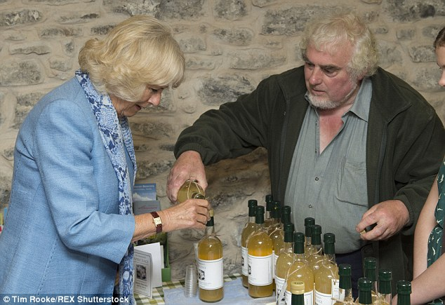 Tipple: The Duchess of Cornwall enjoys a glass of local wine while visiting the Royal Oak pub