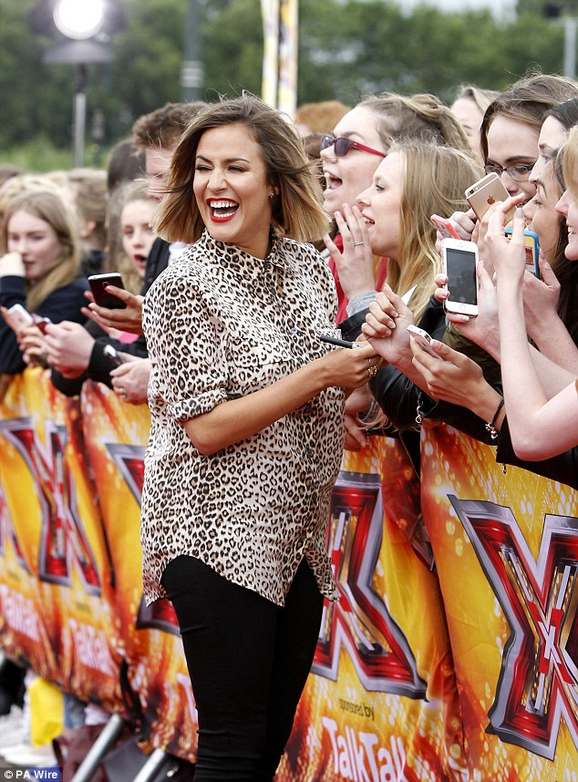 Exciting: The TV presenter appeared to be in high spirits as she signed autographs