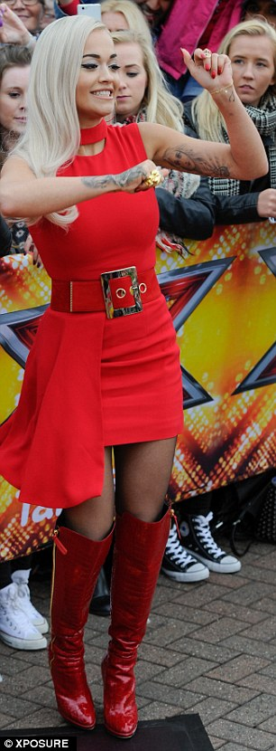 Lady in red: Rita oped for a Seventies style scarlet dress and matching over-the-knee boots