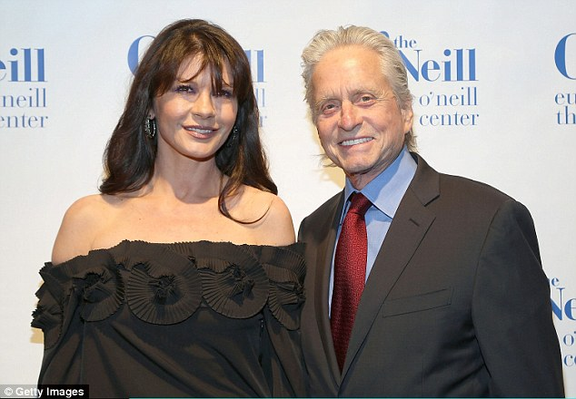 Fatal Attraction star Michael Douglas, pictured with his wife Catherine Zeta-Jones, claims American actors' are losing out on top roles due to their preoccupation with social media