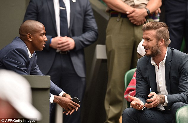 Footie friends: David was seen talking to Manchester United and England footballer Ashley Young