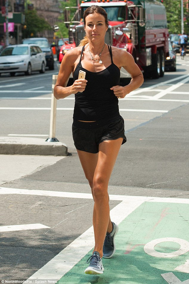 Running circles: Kelly Bensimon was seen out on one of her usual brisk runs in New York City on Wednesday