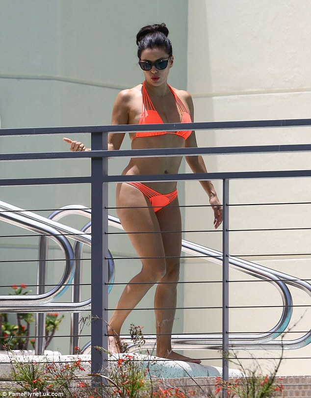 Pre-holiday tanning session... In Miami last Wednesday Longoria looked amazing in a neon bright set