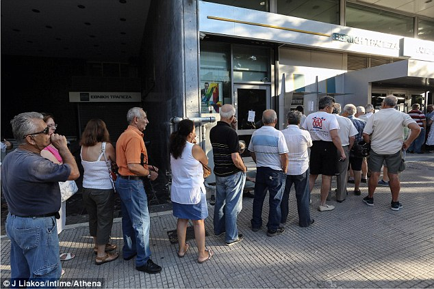 Cash-strapped: Greeks  continue to queue for hours at bank ATMs (pictured in Athens) to withdraw their daily cash allowance which has been forced down to €50 a day