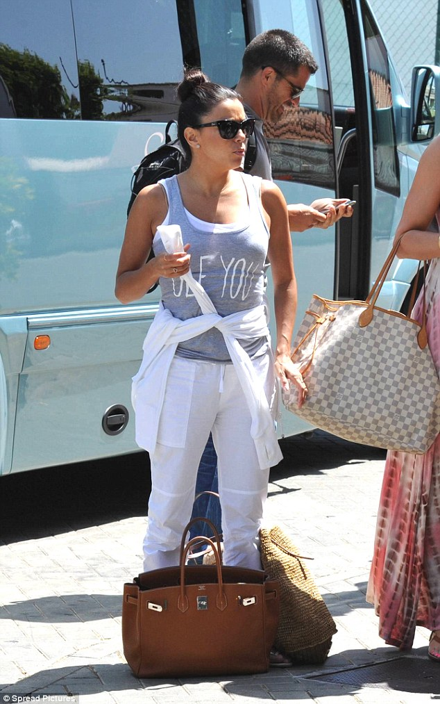 Flight ready! The 40-year-old actress wore a printed vest top with white joggers and flip flops