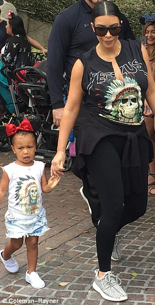 Partying: The two-year-old child was at the amusement park to help her cousin Penelope Disick ring in her third birthday
